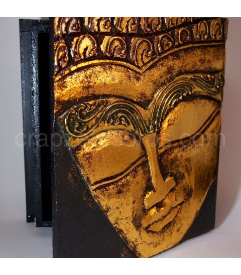 Rostro de Buda tallado y policromado en caja de madera de la India.