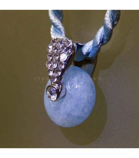 Aguamarina talla donut en colgante de metal con circonitas y cordón a juego