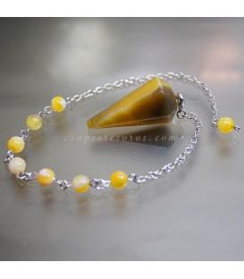 Ágata amarilla tallada como péndulo radiestesia
