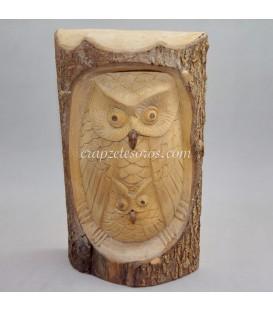 Buda en tronco natural.