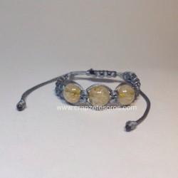Cuarzos rutilados en esfera en sujeta pañuelos ajustable de macramé
