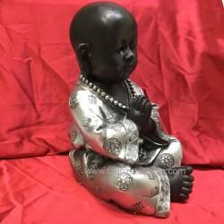Buda niño plateado meditando