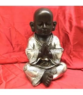 Buda niño negro y plateado meditando en resina