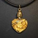 Laminas de Oro de ley en colgante con corazon de cristal